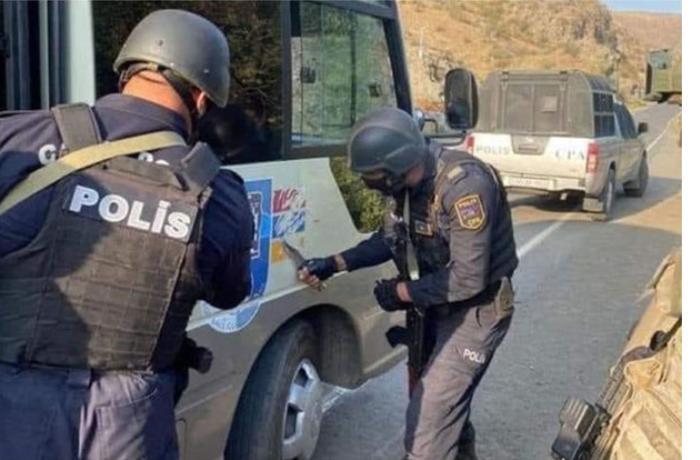 """Qondarma rejimin """"bayrağı""""nı silən polis kimdir? — FOTOLAR"""